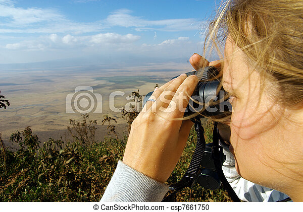 Young lady observing nature with binoculars - csp7661750