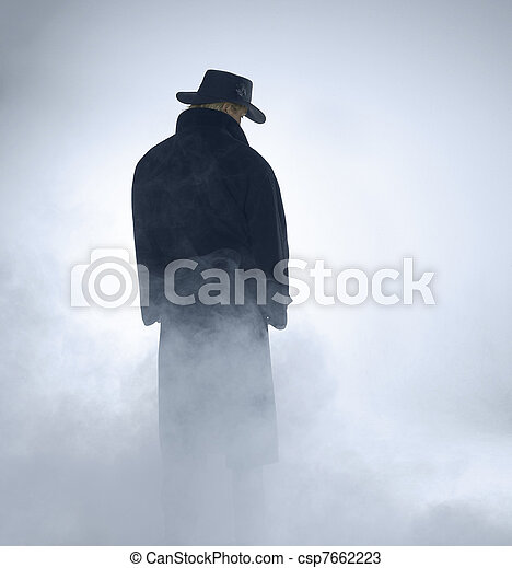 Woman wearing trench coat and standing in fog - csp7662223