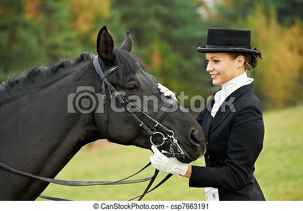 horsewoman jockey in uniform with horse - csp7663191