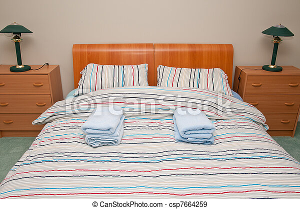 Simple hostel or hotel bedroom - csp7664259