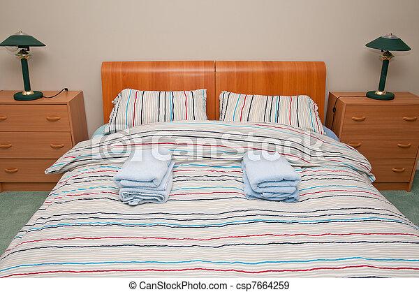 Simple hostel or hotel bedroom - csp7664259