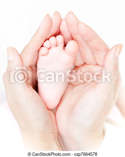 Mother's hands carefully keep baby's foot with tenderness - csp7664578