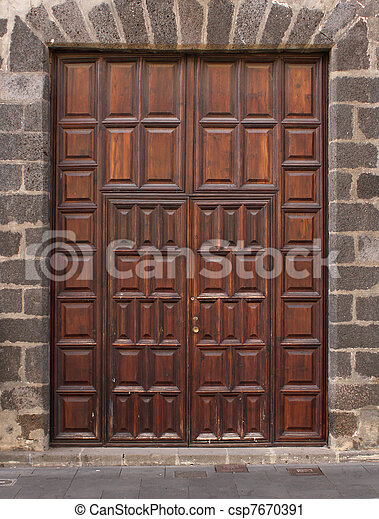 Imposing wooden doors entry - csp7670391