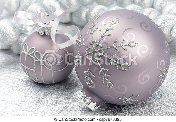 Christmas balls on the silver background - csp7670395
