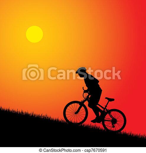 Biker riding up to hill - csp7670591