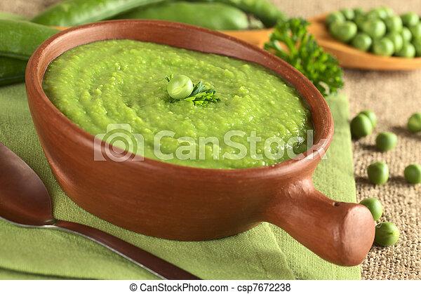 Fresh green pea soup in rustic bowl - csp7672238