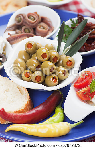 Pickled olives with other antipasto food - csp7672372