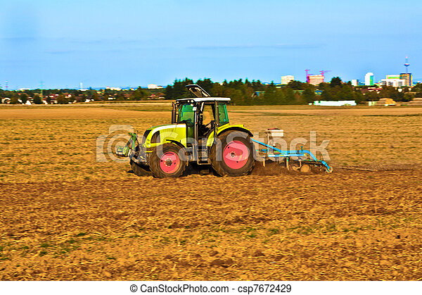 Small scale farming with tractor and plow - csp7672429