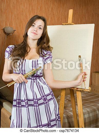 girl near easel with canvas.