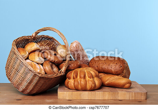Assortment of bread in a basket - csp7677707
