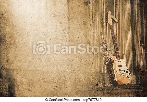 old grungy sax with electric guitar in retro look - csp7677810