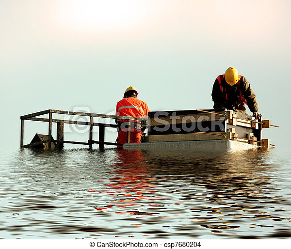 Two builders on huge submerged  pillar - csp7680204