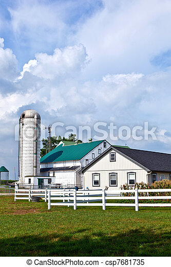 farm house with field and silo - csp7681735