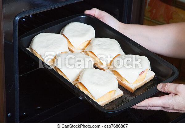 Photo cuisinier mettre bourr l gume moelle four for Cuisinier 3 etoiles legumes