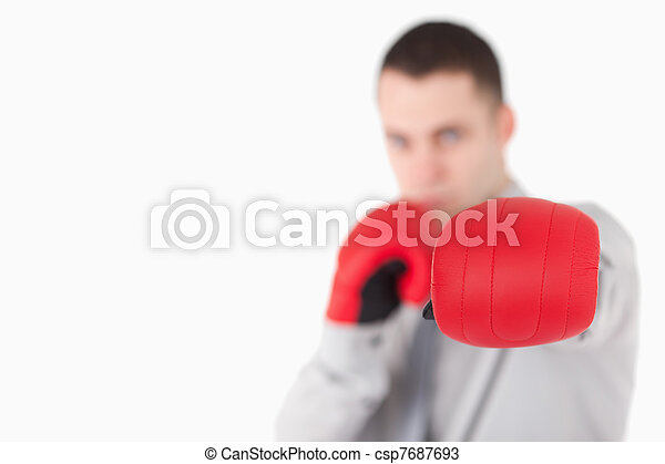 Businessman wearing boxing gloves - csp7687693