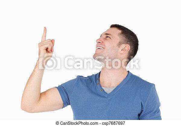 Smiling man pointing at something - csp7687697