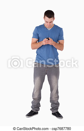 Portrait of a man sending text messages - csp7687780