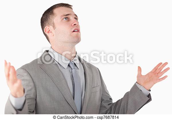 Worried entrepreneur praying - csp7687814