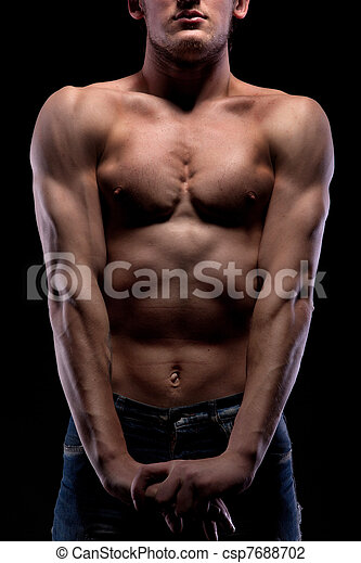 Muscular naked man on black - csp7688702