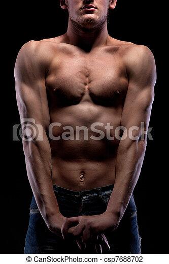 Muscular naked man on black - csp7688702