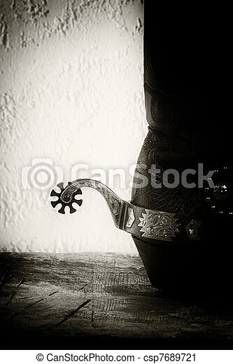 Shoes and spurs. Retro styled Western still life - csp7689721