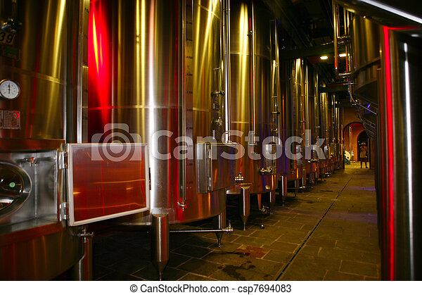 Modern stainless steel fermenting tanks for wine making  - csp7694083