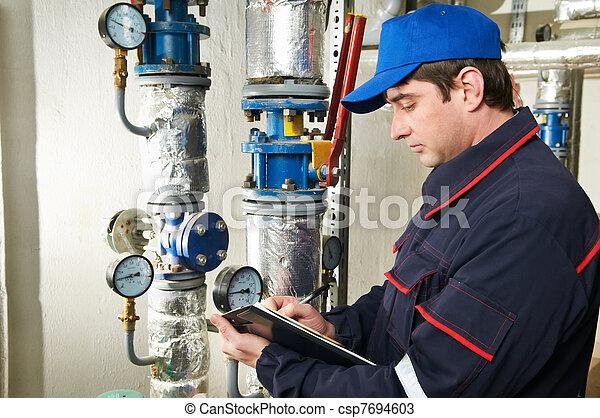 heating engineer repairman in boiler room - csp7694603