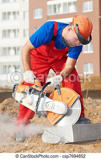 builder at cutting curb work - csp7694852