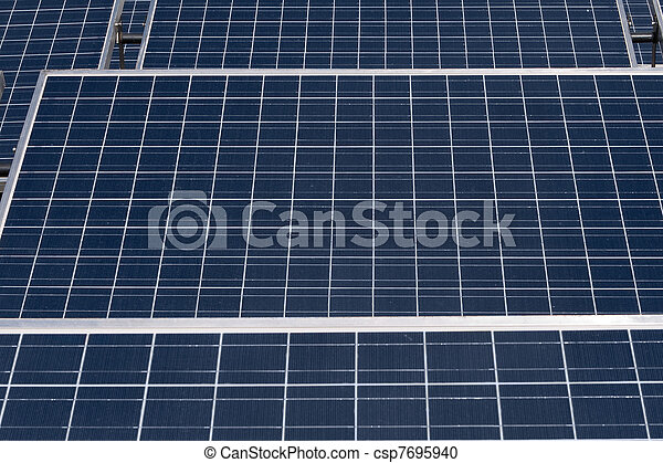 Rows of Tilted Photovoltaic Solar Panels - csp7695940