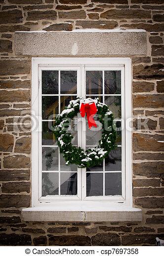 Christmas Wreath on Old Window Pane - csp7697358