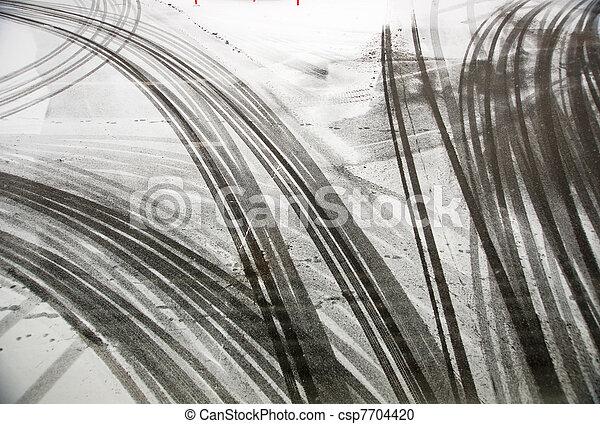 Tire tracks on asphalt - csp7704420