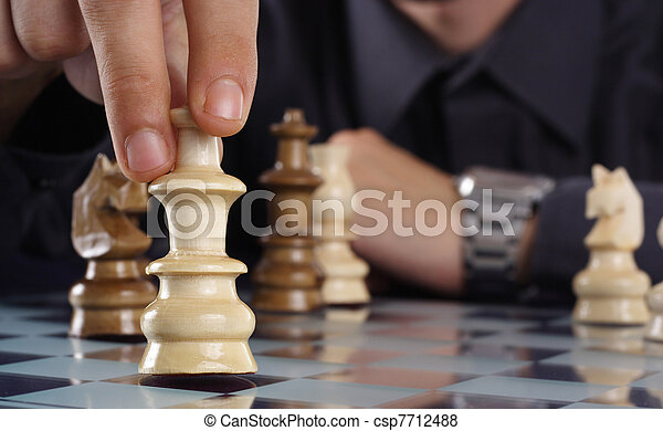 Businessman playing chess - csp7712488
