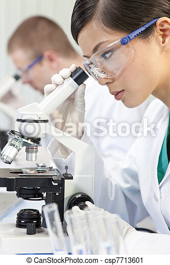 Chinese Female Woman Scientist & Microscope In Laboratory - csp7713601