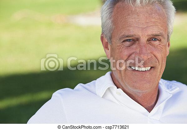 Happy Handsome Senior Man Smiling Outside - csp7713621