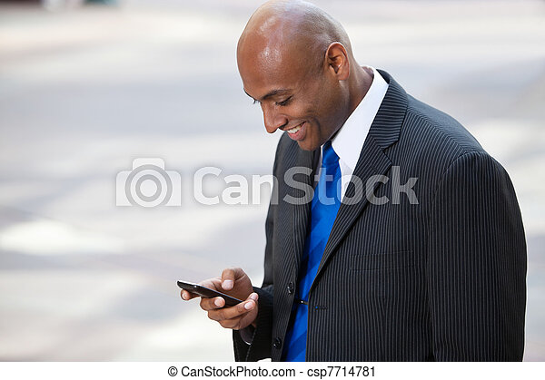 African American Business Man Texting - csp7714781