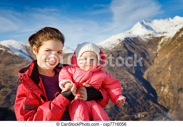 Mother with baby in sport costumes - csp7716056