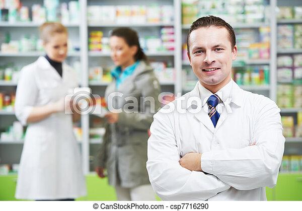 Confident pharmacy chemist man in drugstore - csp7716290