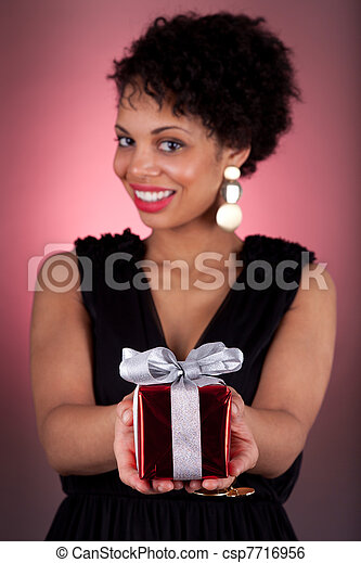 Young African American woman offering a gift  - csp7716956