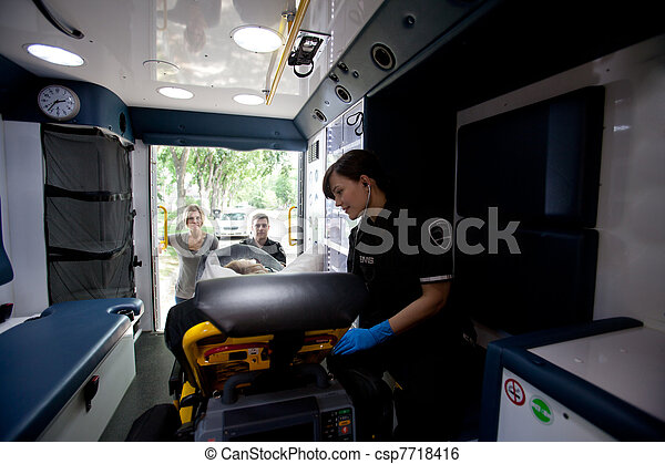 Ambulance Interior with Patient and Paramedic - csp7718416