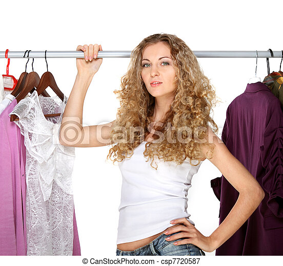 Portrait of a blonde beautiful girl selecting clothes - csp7720587