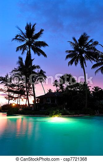 Sunset and illuminated swimming pool, Bentota, Sri Lanka - csp7721368