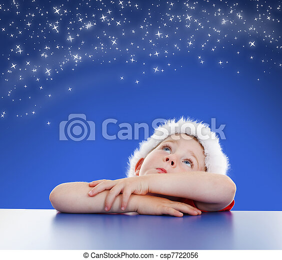 Little boy looking up to starry night sky - csp7722056