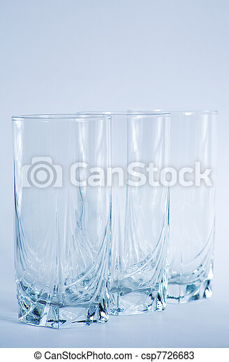 Decorative drinking glasses shot in cool blue filtering. - csp7726683