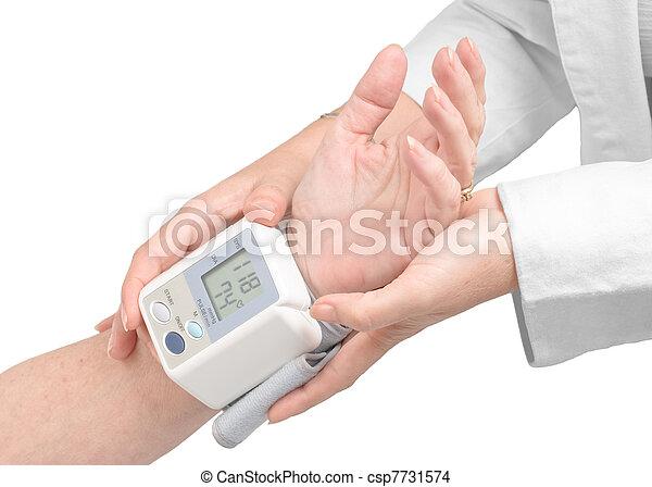 Medical assistance measuring blood pressure - csp7731574