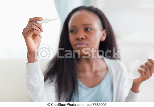 Close up of woman measuring temperature - csp7732005