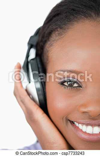 Close up of young woman with headphones on white background - csp7733243