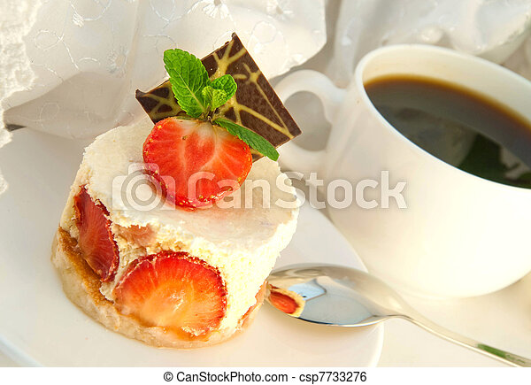Cake from cream and a strawberry with mint, a cup of coffee - csp7733276