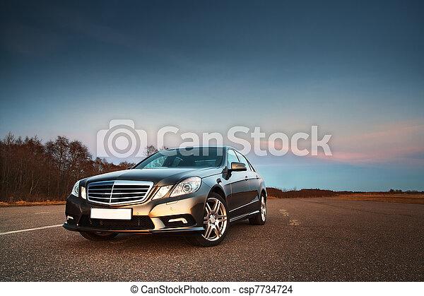 Car in the light of evening sun - csp7734724