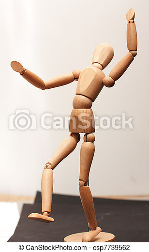 Wood manequin dancing - csp7739562