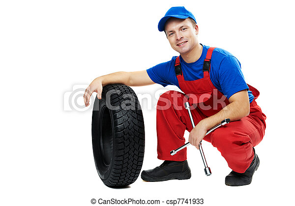 automobile mechanic with car tire and spanner - csp7741933